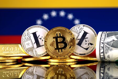 Physical version of Bitcoin, Litecoin, gold, US Dollar and Venezuela Flag. Conceptual image for investors in cryptocurrency, gold and dollars. Stock Photo