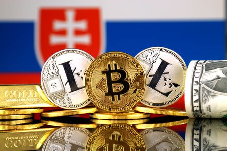 Physical version of Bitcoin, Litecoin, gold, US Dollar and Slovakia Flag. Conceptual image for investors in cryptocurrency, gold and dollars.