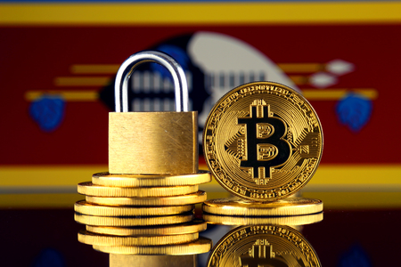 Physical version of Bitcoin, golden padlock and Swaziland Flag. Prohibition of cryptocurrencies, regulations, restrictions or security, protection, privacy.