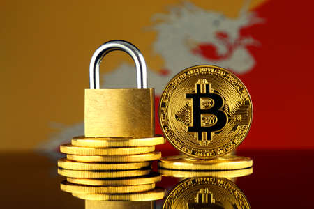 Physical version of Bitcoin, golden padlock and Bhutan Flag. Prohibition of cryptocurrencies, regulations, restrictions or security, protection, privacy.