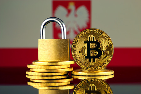 Physical version of Bitcoin, golden padlock and Poland Flag. Prohibition of cryptocurrencies, regulations, restrictions or security, protection, privacy. Archivio Fotografico