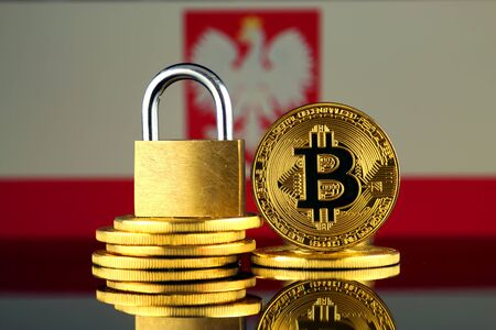 Physical version of Bitcoin, golden padlock and Poland Flag. Prohibition of cryptocurrencies, regulations, restrictions or security, protection, privacy. Stock Photo