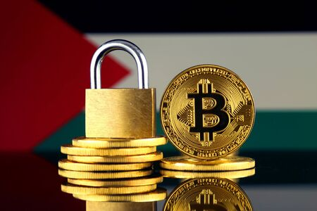 Physical version of Bitcoin, golden padlock and Palestine Flag. Prohibition of cryptocurrencies, regulations, restrictions or security, protection, privacy.