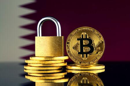 Physical version of Bitcoin, golden padlock and Qatar Flag. Prohibition of cryptocurrencies, regulations, restrictions or security, protection, privacy.