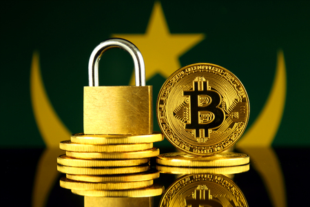 Physical version of Bitcoin, golden padlock and Mauritania Flag. Prohibition of cryptocurrencies, regulations, restrictions or security, protection, privacy. Stock Photo