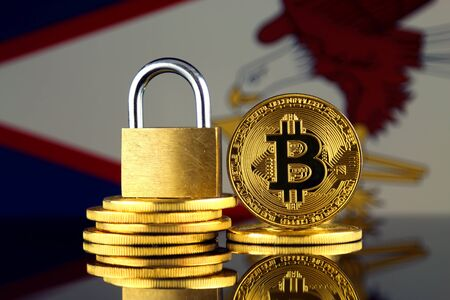 Physical version of Bitcoin, golden padlock and American Samoa Flag. Prohibition of cryptocurrencies, regulations, restrictions or security, protection, privacy. Stock Photo
