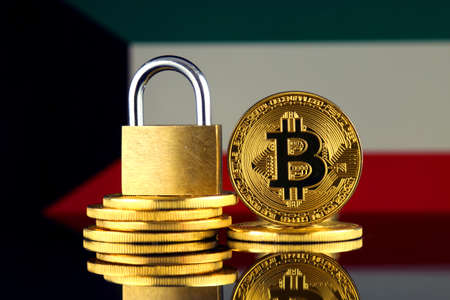 Physical version of Bitcoin, golden padlock and Kuwait Flag. Prohibition of cryptocurrencies, regulations, restrictions or security, protection, privacy.
