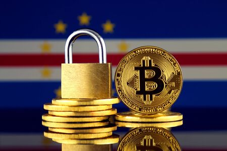 Physical version of Bitcoin, golden padlock and Cape Verde Flag. Prohibition of cryptocurrencies, regulations, restrictions or security, protection, privacy.