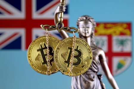 Symbol of law and justice, physical version of Bitcoin and Fiji Flag. Prohibition of cryptocurrencies, regulations, restrictions or security, protection, privacy.