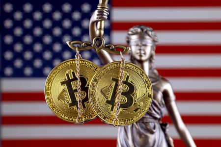 Symbol of law and justice, physical version of Bitcoin and United States Flag. Prohibition of cryptocurrencies, regulations, restrictions or security, protection, privacy. Zdjęcie Seryjne