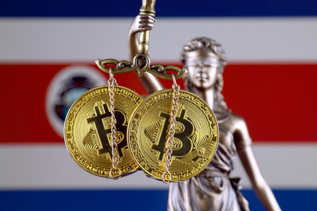 Symbol of law and justice, physical version of Bitcoin and Costa Rica Flag. Prohibition of cryptocurrencies, regulations, restrictions or security, protection, privacy.