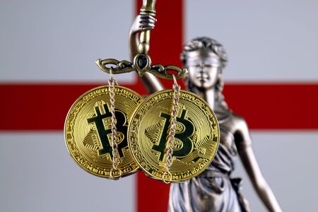 Symbol of law and justice, physical version of Bitcoin and England Flag. Prohibition of cryptocurrencies, regulations, restrictions or security, protection, privacy.
