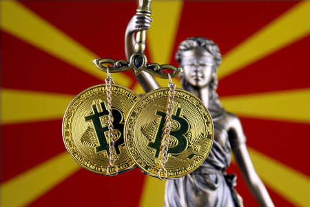 Symbol of law and justice, physical version of Bitcoin and Macedonia Flag. Prohibition of cryptocurrencies, regulations, restrictions or security, protection, privacy.