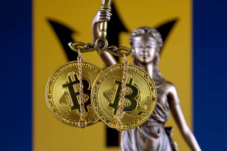 Symbol of law and justice, physical version of Bitcoin and Barbados Flag. Prohibition of cryptocurrencies, regulations, restrictions or security, protection, privacy. Stock Photo