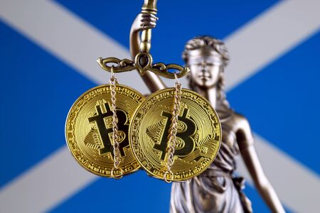 Symbol of law and justice, physical version of Bitcoin and Scotland Flag. Prohibition of cryptocurrencies, regulations, restrictions or security, protection, privacy.