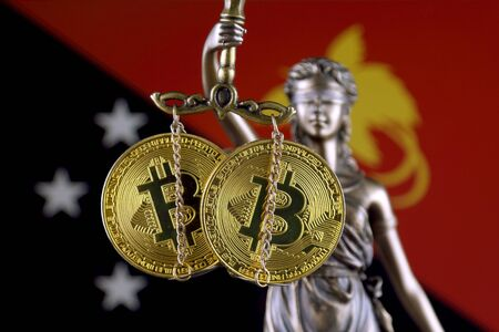 Symbol of law and justice, physical version of Bitcoin and Papua New Guinea Flag. Prohibition of cryptocurrencies, regulations, restrictions or security, protection, privacy.