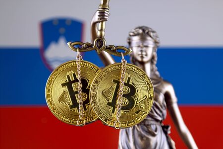 Symbol of law and justice, physical version of Bitcoin and Slovenia Flag. Prohibition of cryptocurrencies, regulations, restrictions or security, protection, privacy.