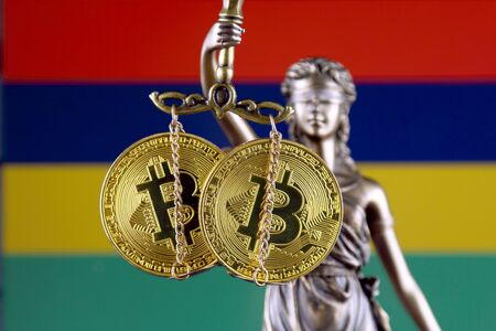 Symbol of law and justice, physical version of Bitcoin and Mauritius Flag. Prohibition of cryptocurrencies, regulations, restrictions or security, protection, privacy.