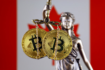 Symbol of law and justice, physical version of Bitcoin and Canada Flag. Prohibition of cryptocurrencies, regulations, restrictions or security, protection, privacy.