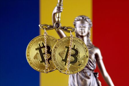 Symbol of law and justice, physical version of Bitcoin and Romania Flag. Prohibition of cryptocurrencies, regulations, restrictions or security, protection, privacy.