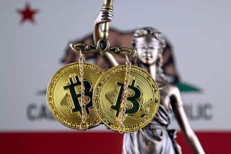 Symbol of law and justice, physical version of Bitcoin and California State Flag. Prohibition of cryptocurrencies, regulations, restrictions or security, protection, privacy. Stock Photo