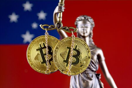 Symbol of law and justice, physical version of Bitcoin and Samoa Flag. Prohibition of cryptocurrencies, regulations, restrictions or security, protection, privacy. Zdjęcie Seryjne