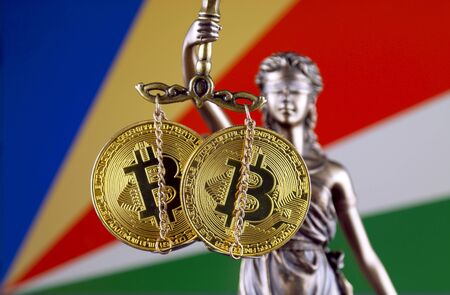 Symbol of law and justice, physical version of Bitcoin and Seychelles Flag. Prohibition of cryptocurrencies, regulations, restrictions or security, protection, privacy.