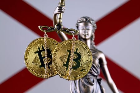 Symbol of law and justice, physical version of Bitcoin and Alabama State Flag. Prohibition of cryptocurrencies, regulations, restrictions or security, protection, privacy.