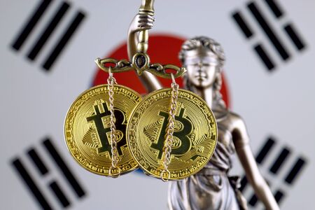 Symbol of law and justice, physical version of Bitcoin and South Korea Flag. Prohibition of cryptocurrencies, regulations, restrictions or security, protection, privacy. Stock Photo