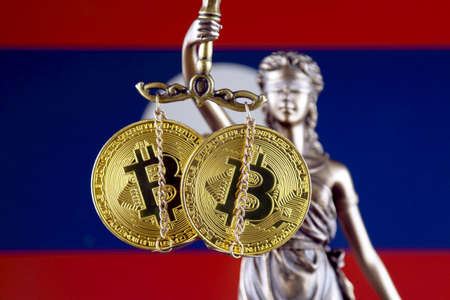 Symbol of law and justice, physical version of Bitcoin and Laos Flag. Prohibition of cryptocurrencies, regulations, restrictions or security, protection, privacy.