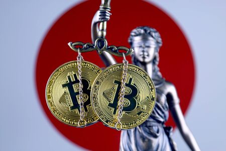 Symbol of law and justice, physical version of Bitcoin and Japan Flag. Prohibition of cryptocurrencies, regulations, restrictions or security, protection, privacy.