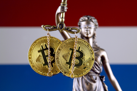 Symbol of law and justice, physical version of Bitcoin and Netherlands Flag. Prohibition of cryptocurrencies, regulations, restrictions or security, protection, privacy.