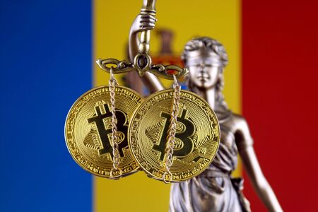 Symbol of law and justice, physical version of Bitcoin and Moldova Flag. Prohibition of cryptocurrencies, regulations, restrictions or security, protection, privacy. Stock Photo