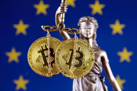 Symbol of law and justice, physical version of Bitcoin and European Union Flag. Prohibition of cryptocurrencies, regulations, restrictions or security, protection, privacy. Zdjęcie Seryjne