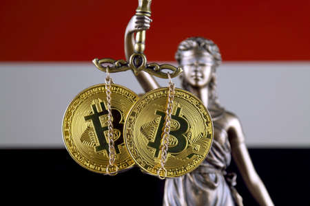 Symbol of law and justice, physical version of Bitcoin and Yemen Flag. Prohibition of cryptocurrencies, regulations, restrictions or security, protection, privacy.