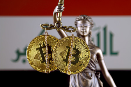 Symbol of law and justice, physical version of Bitcoin and Iraq Flag. Prohibition of cryptocurrencies, regulations, restrictions or security, protection, privacy.