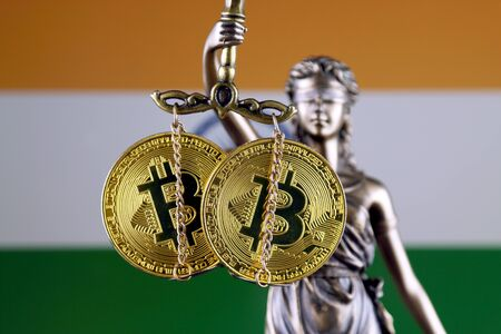 Symbol of law and justice, physical version of Bitcoin and India Flag. Prohibition of cryptocurrencies, regulations, restrictions or security, protection, privacy.