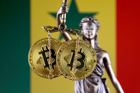 Symbol of law and justice, physical version of Bitcoin and Senegal Flag. Prohibition of cryptocurrencies, regulations, restrictions or security, protection, privacy.