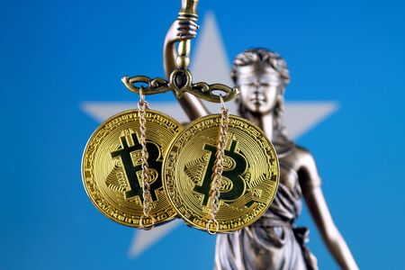 Symbol of law and justice, physical version of Bitcoin and Somalia Flag. Prohibition of cryptocurrencies, regulations, restrictions or security, protection, privacy.