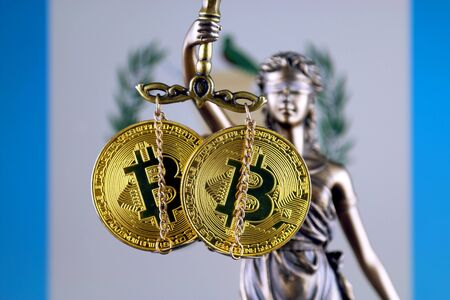 Symbol of law and justice, physical version of Bitcoin and Guatemala Flag. Prohibition of cryptocurrencies, regulations, restrictions or security, protection, privacy.