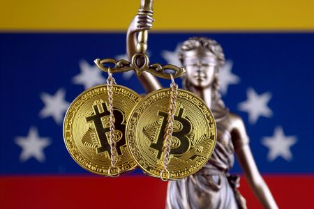 Symbol of law and justice, physical version of Bitcoin and Venezuela Flag. Prohibition of cryptocurrencies, regulations, restrictions or security, protection, privacy.