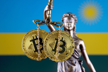Symbol of law and justice, physical version of Bitcoin and Rwanda Flag. Prohibition of cryptocurrencies, regulations, restrictions or security, protection, privacy. Zdjęcie Seryjne