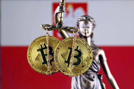 Symbol of law and justice, physical version of Bitcoin and Poland Flag. Prohibition of cryptocurrencies, regulations, restrictions or security, protection, privacy.