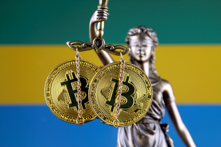 Symbol of law and justice, physical version of Bitcoin and Gabon Flag. Prohibition of cryptocurrencies, regulations, restrictions or security, protection, privacy. Zdjęcie Seryjne