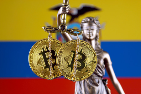 Symbol of law and justice, physical version of Bitcoin and Ecuador Flag. Prohibition of cryptocurrencies, regulations, restrictions or security, protection, privacy.