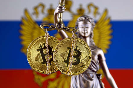 Symbol of law and justice, physical version of Bitcoin and Russia Flag. Prohibition of cryptocurrencies, regulations, restrictions or security, protection, privacy.