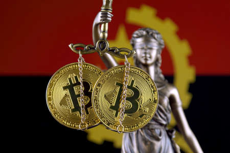 Symbol of law and justice, physical version of Bitcoin and Angola Flag. Prohibition of cryptocurrencies, regulations, restrictions or security, protection, privacy.