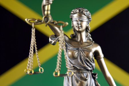 Symbol of law and justice with Jamaica Flag. Close up. Stock Photo