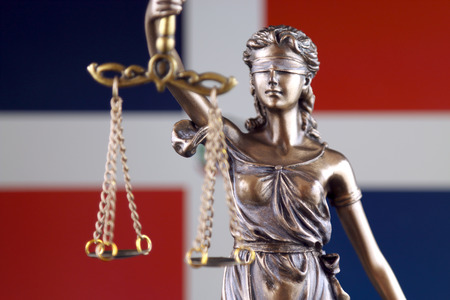 Symbol of law and justice with Dominican Republic Flag. Close up.