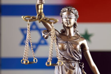 Symbol of law and justice with Israel and Syria Flag. Close up. Stock Photo